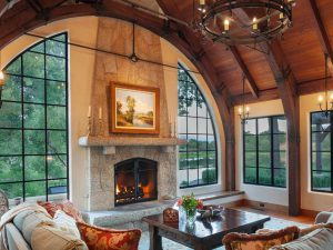 Central Fireplace Surrounded by View Windows